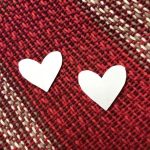 Paper hearts on handwoven fabric