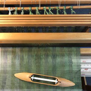 Yarn waste on floor loom